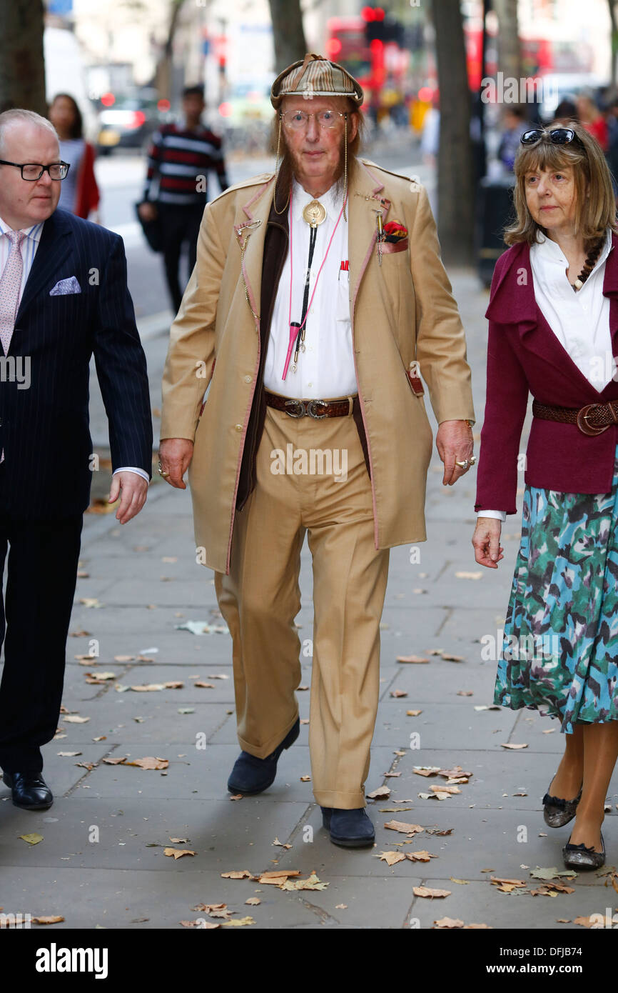John McCririck and his wife Jenny McCririck arrive at  employment tribunal vs Channel 4 & others for unfair dismissal in London - Stock Image