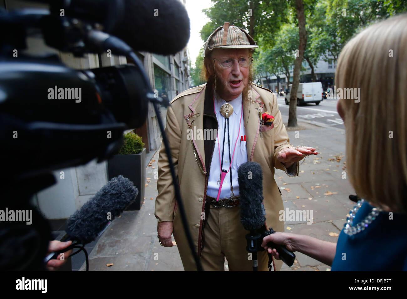 John McCririck arrives at employment tribunal vs Channel 4 & others for unfair dismissal in London Britain 30 September 2013. - Stock Image
