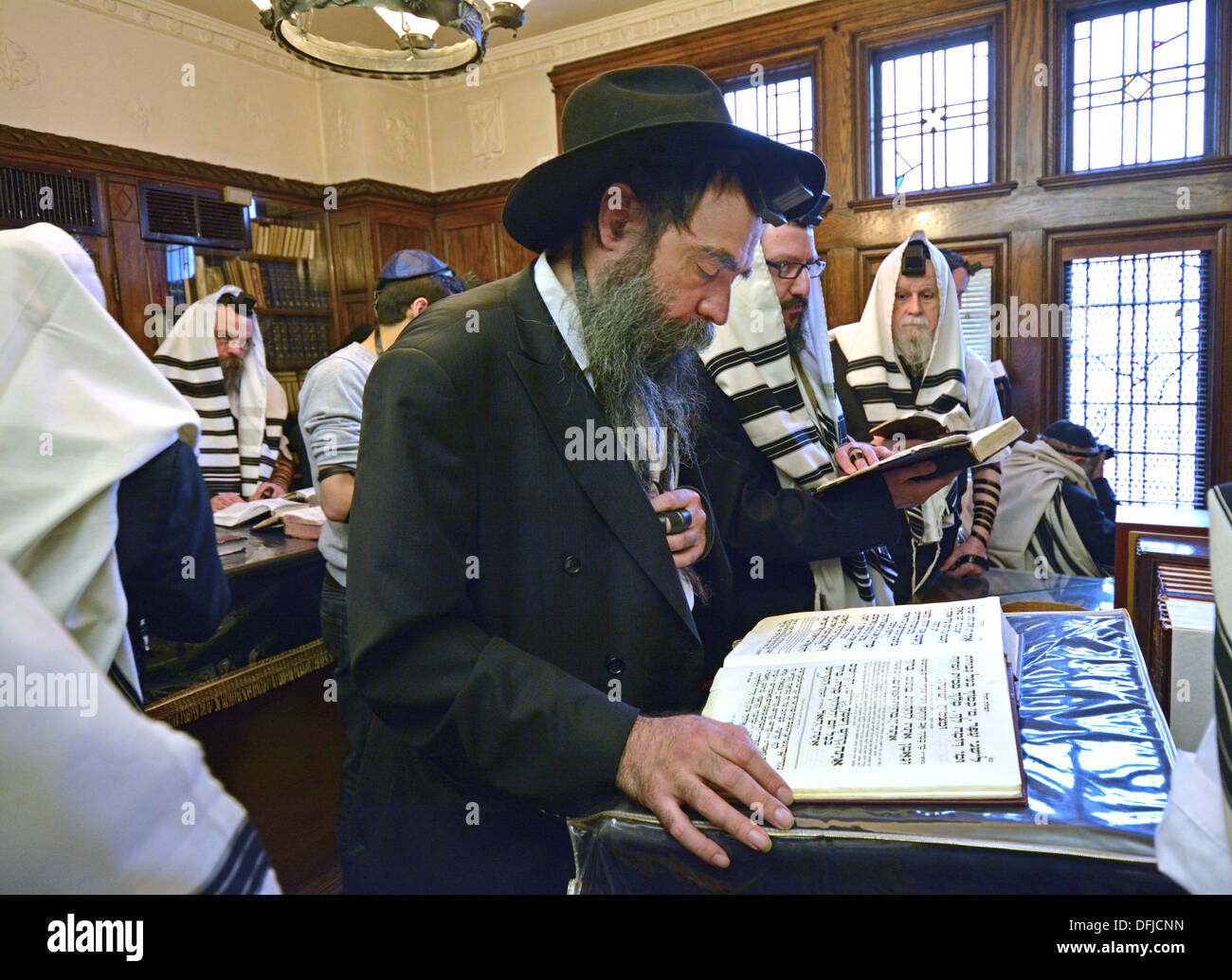 Weekday morning services in the Rebbe's office at Lubavitch Headquarters in Crown Heights, Brooklyn, New York - Stock Image