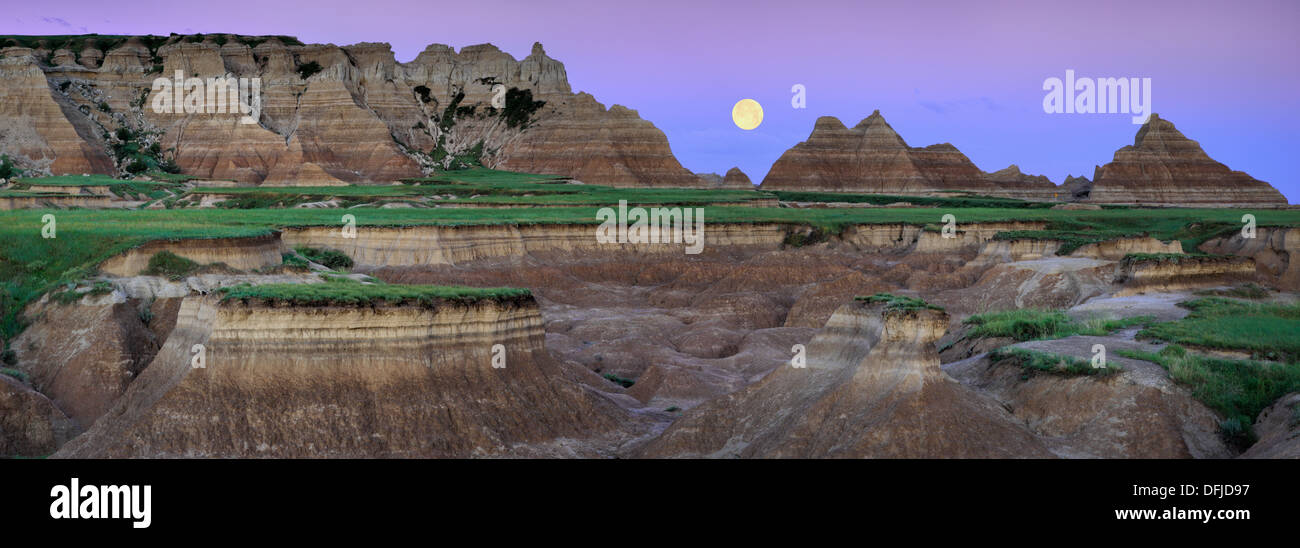 Supermoon over the Badlands as seen along Castle Trail in Badlands National Park, South Dakota - Stock Image