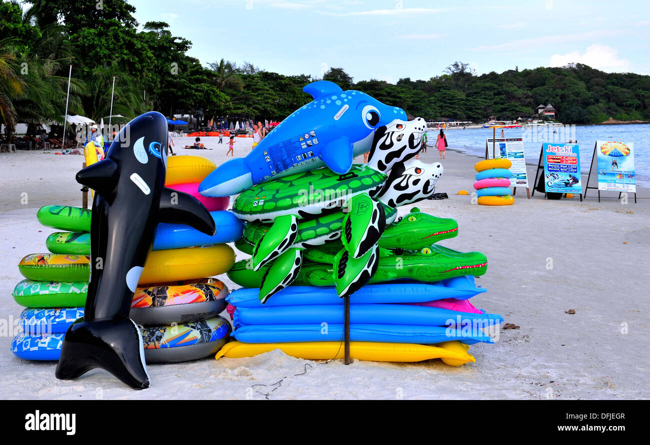 Thailand's islands & beaches - Inflatable sea creature floats for rental on the beach (Koh Samet, Thailand) Stock Photo