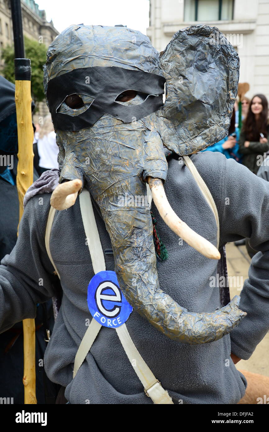 London UK, 4th Oct 2013 : Hundreds of protesters march to Parliament Square, calling on the government to support a worldwide ban on ivory. The demonstrators raised the issue of one elephant being killed every 15 minutes to supply the illegal ivory trade. See Li / Alamy, live news - Stock Image