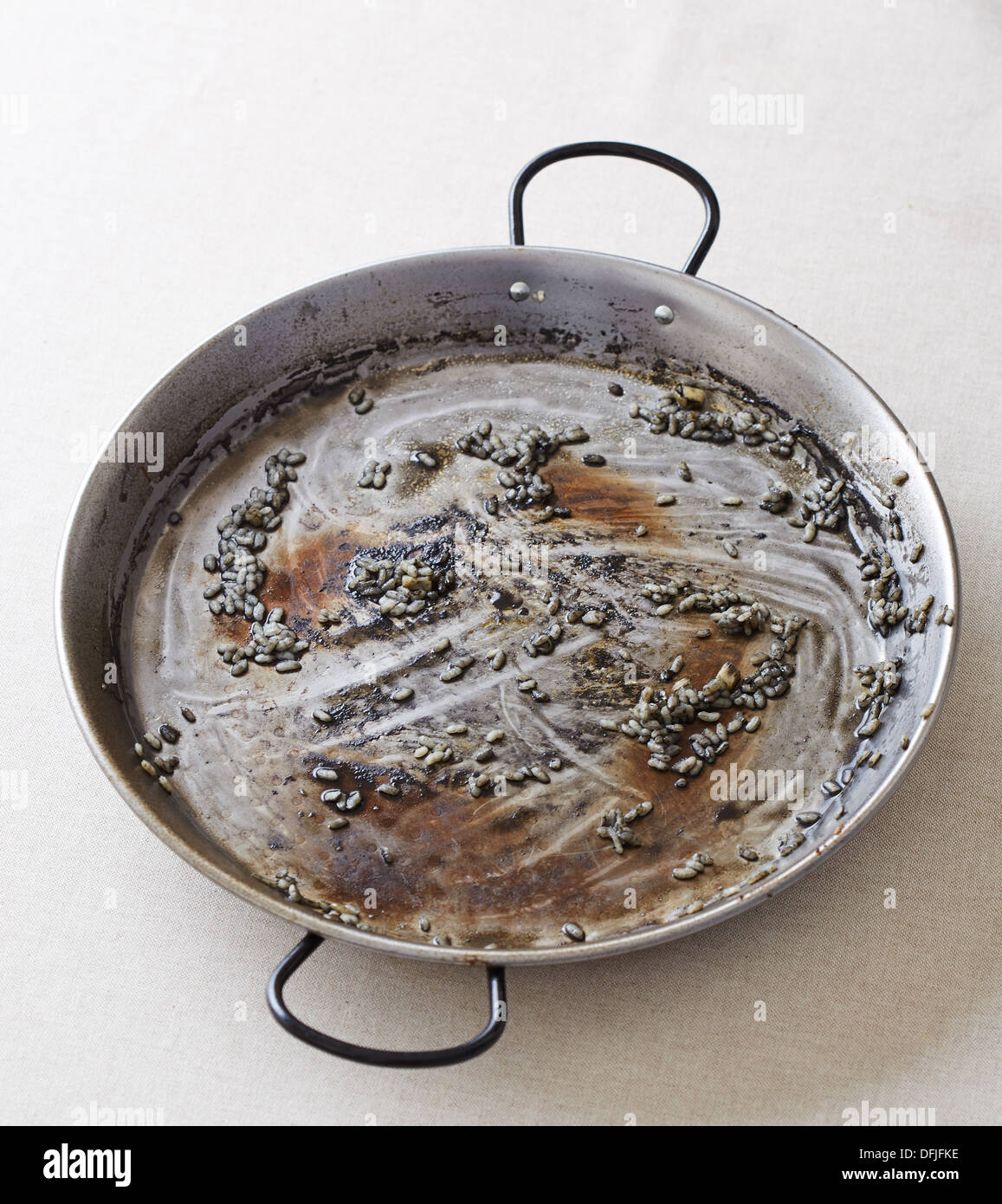Empty pan that used to contain black rice Stock Photo