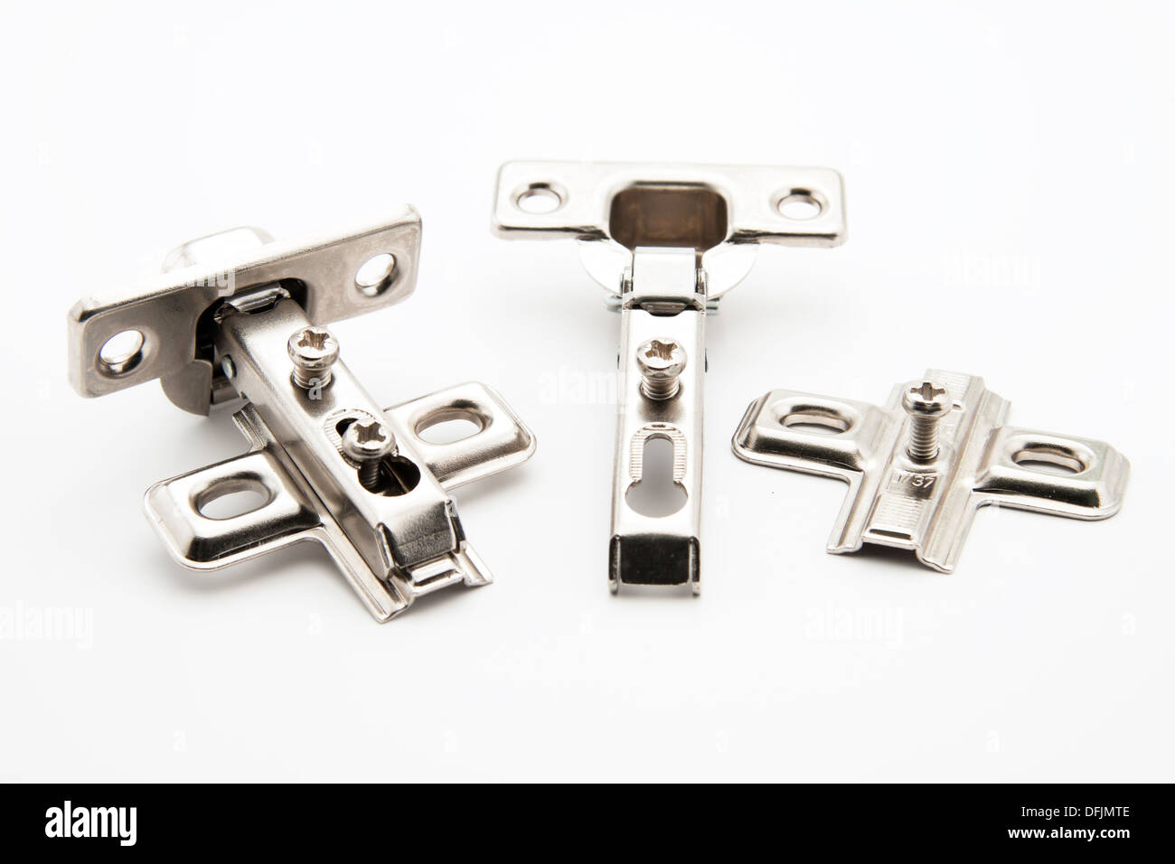 Furniture door hinge connectors on white background - Stock Image
