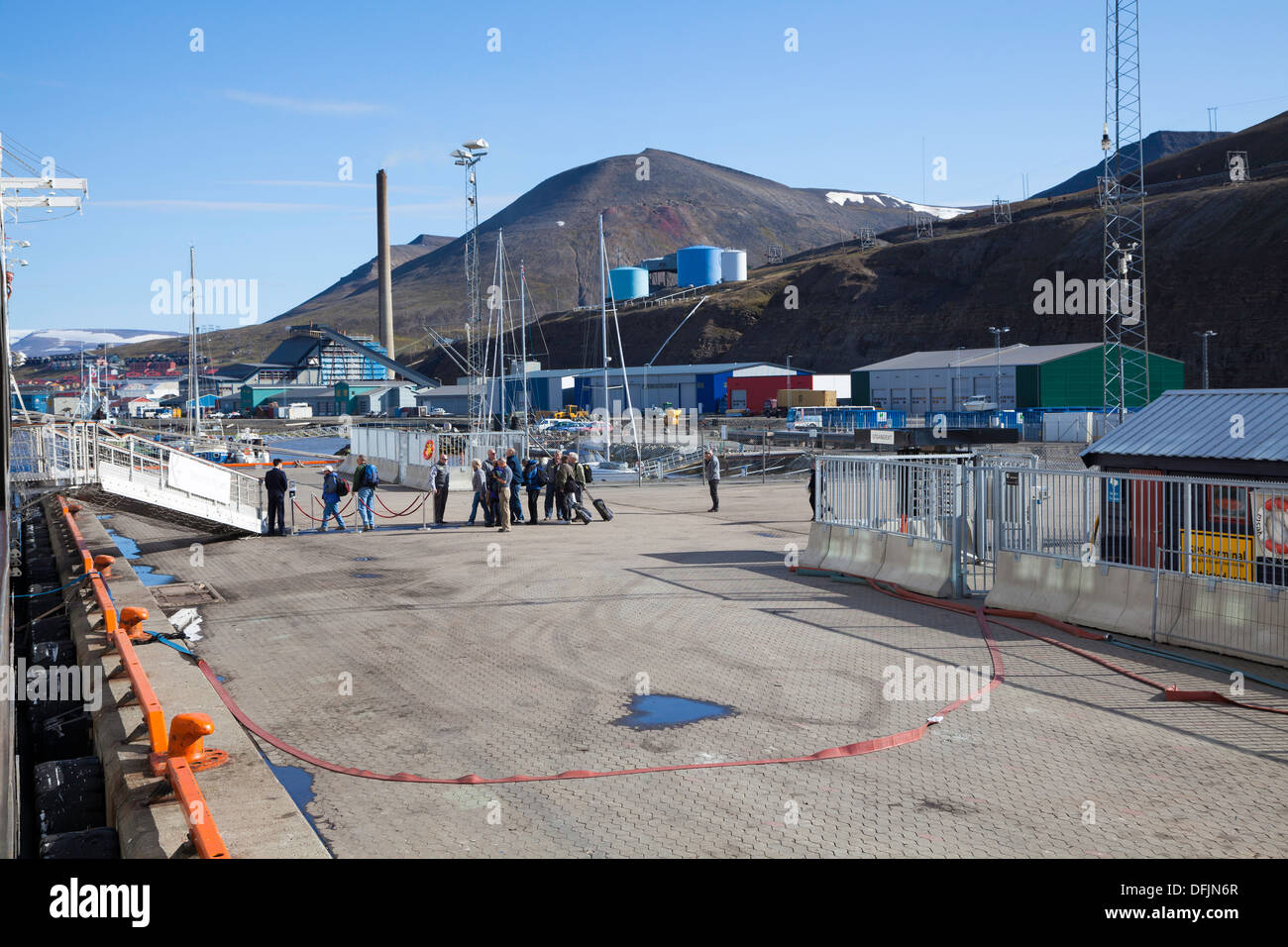 Expedition ship passengers embarking at the wharf at Longyearbyen, Spitsbergen, Norway - Stock Image
