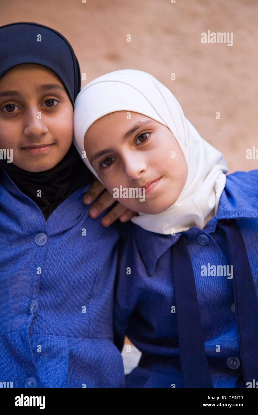 Jordanian school kids on a field trip to the legendary 3rd century Nabataean city of Petra, Jordan. - Stock Image