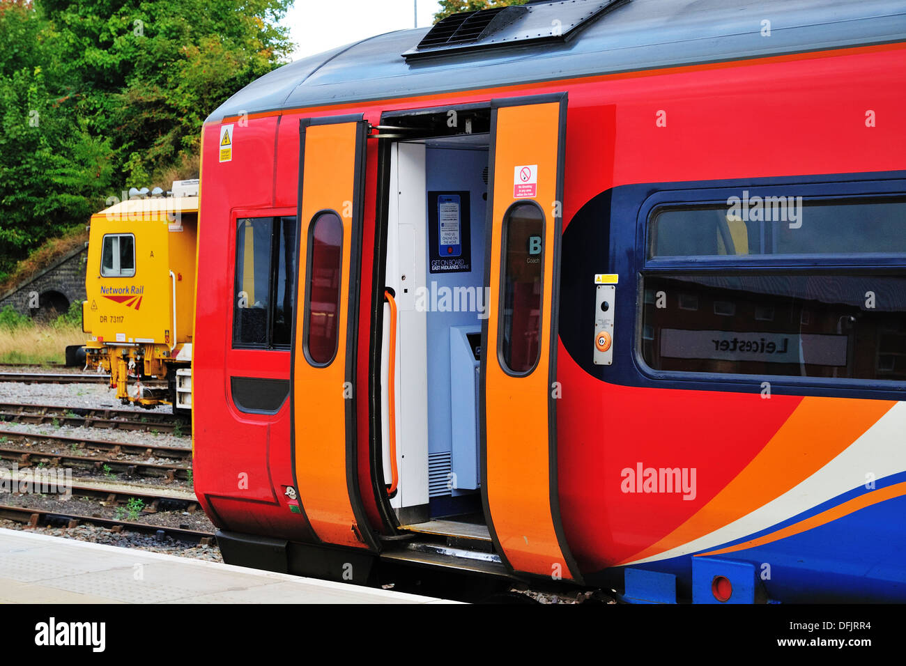 East Midlands Trains regional passenger train waiting at Leicester station with its doors open. - Stock Image