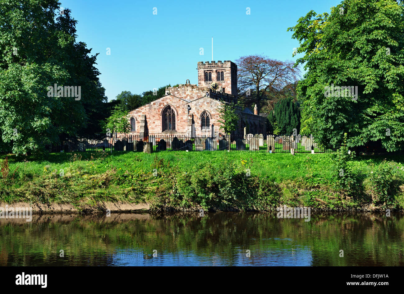 View of St Lawrence's Church in Appleby, Cumbria, on the banks of the river Eden - Stock Image