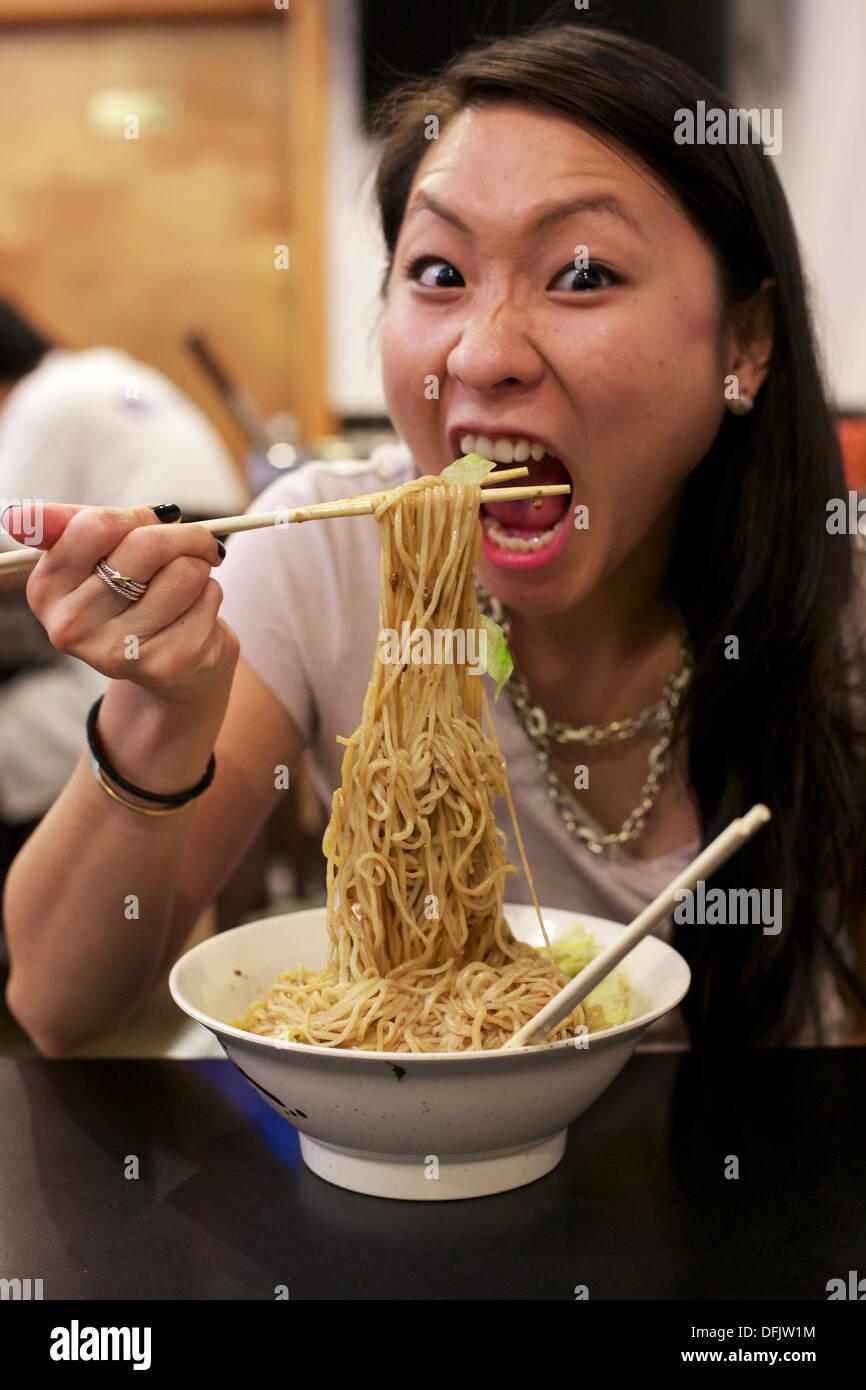 asian-girl-eating-noodles