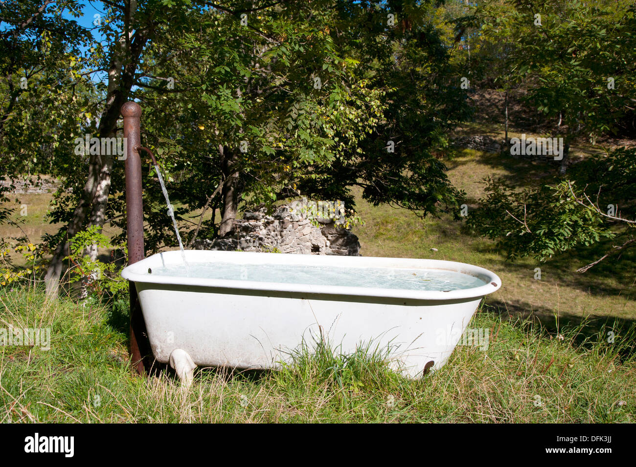Bathtub placed in countryside and used as spring water trough Stock ...