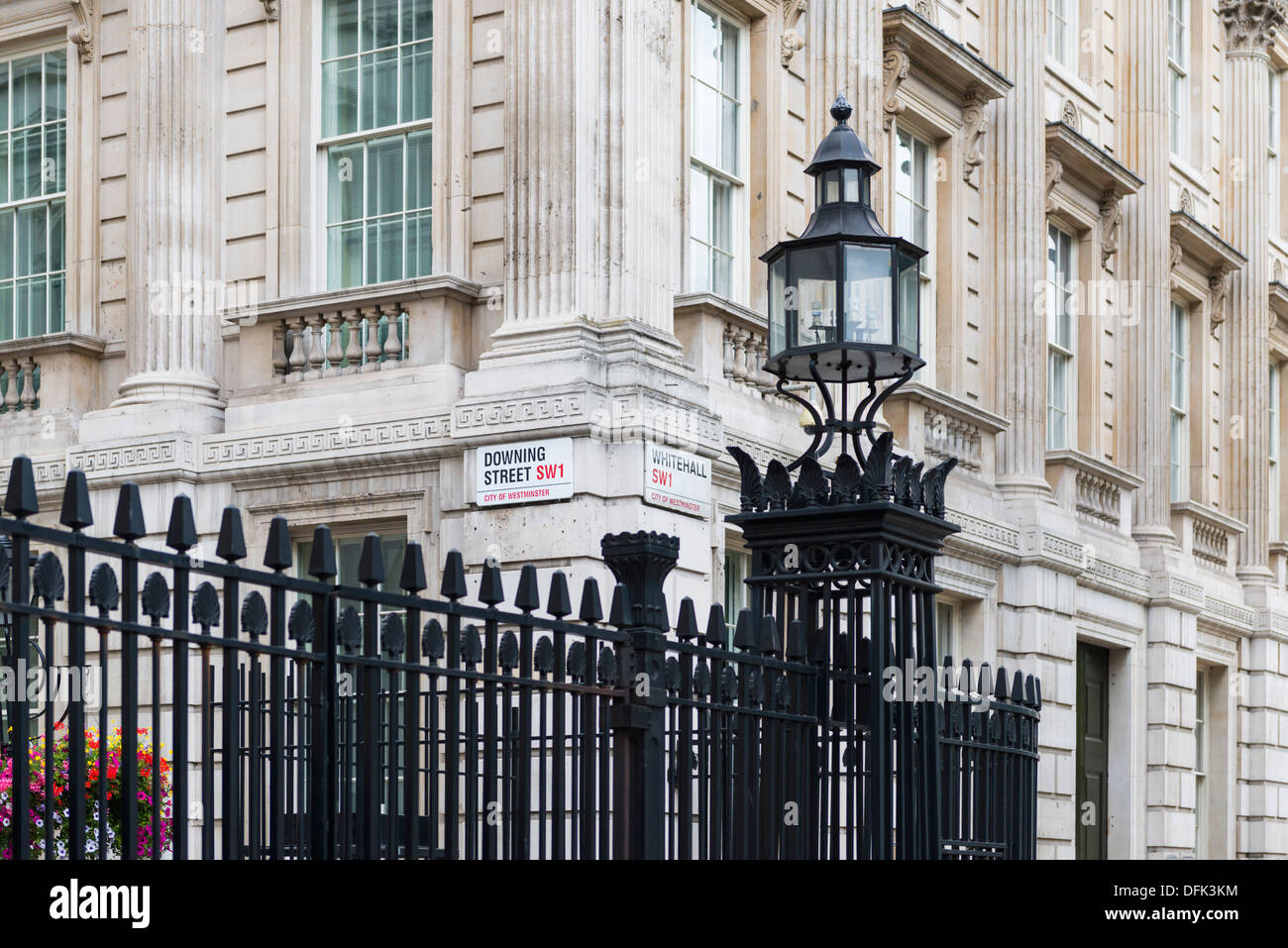 Cropped shot of gates with street signs for Downing Street and Whitehall - Stock Image