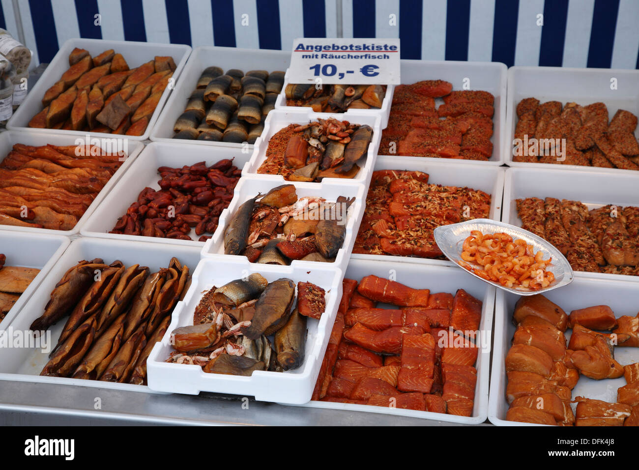 Smoked fish selling in the old harbour of Wismar, Baltic Sea, Mecklenburg West Pomerania, Germany - Stock Image