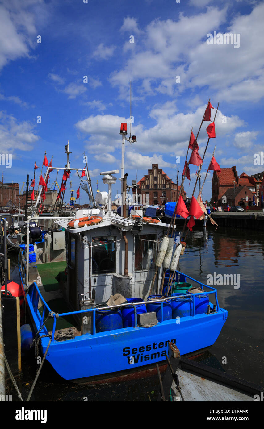 Fish trawler in the old harbour of Wismar, Baltic Sea, Mecklenburg West Pomerania, Germany - Stock Image