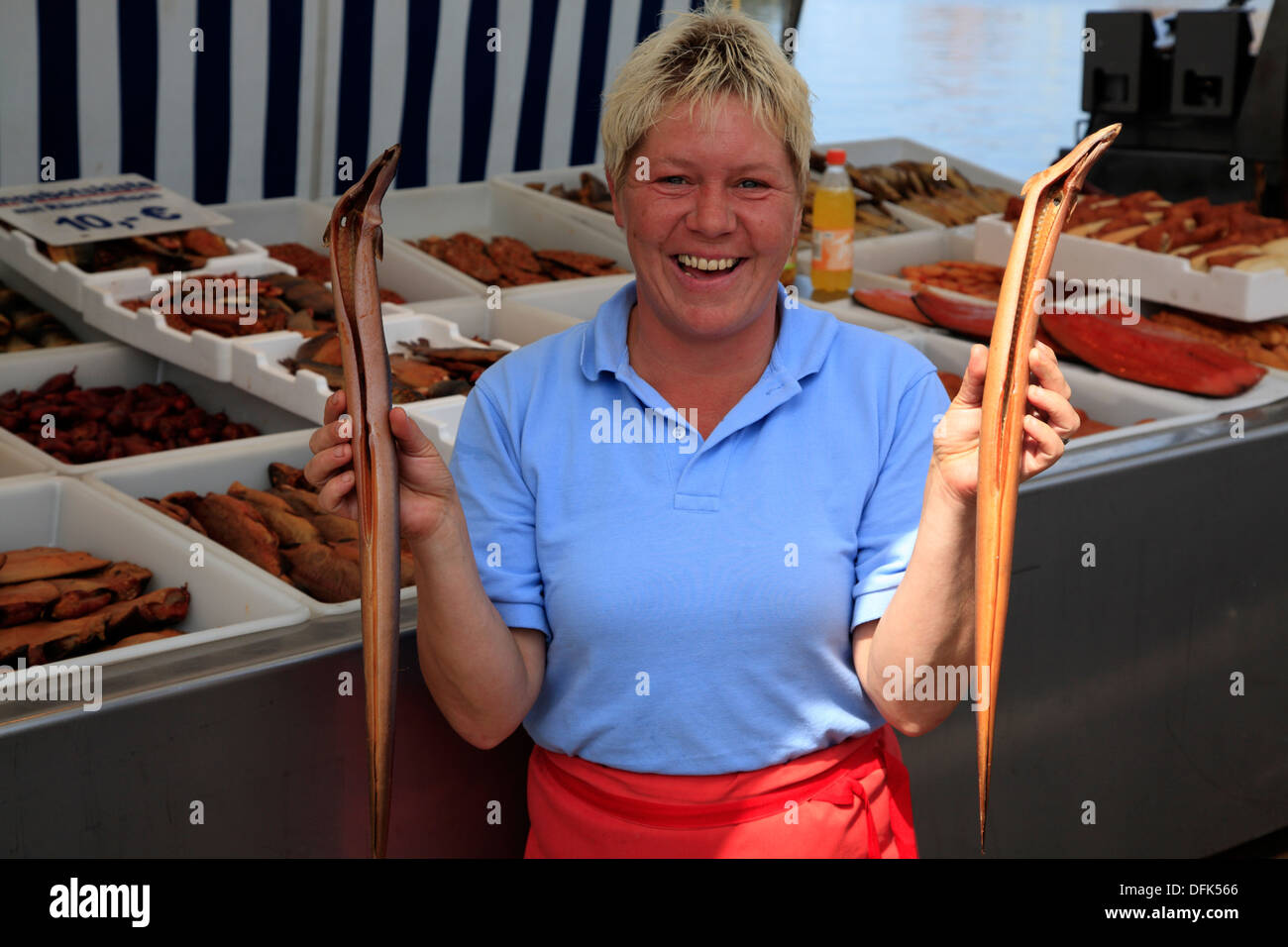 Selling smoked fish from the trawler, Wismar harbour, Baltic Sea, Mecklenburg-West Pomerania, Germany - Stock Image