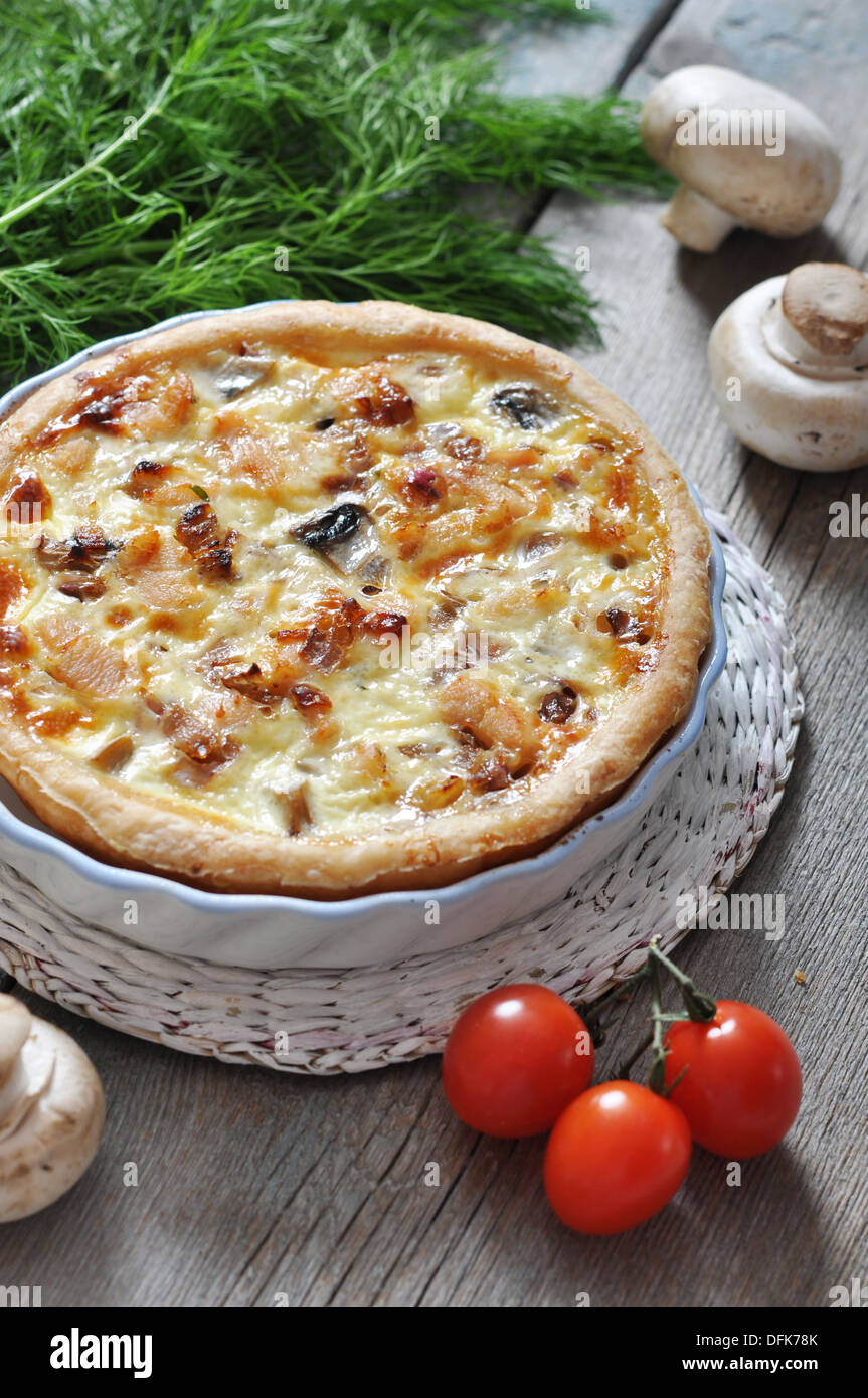 Traditional french quiche pie with chicken and mushroom on a plate & Traditional french quiche pie with chicken and mushroom on a plate ...