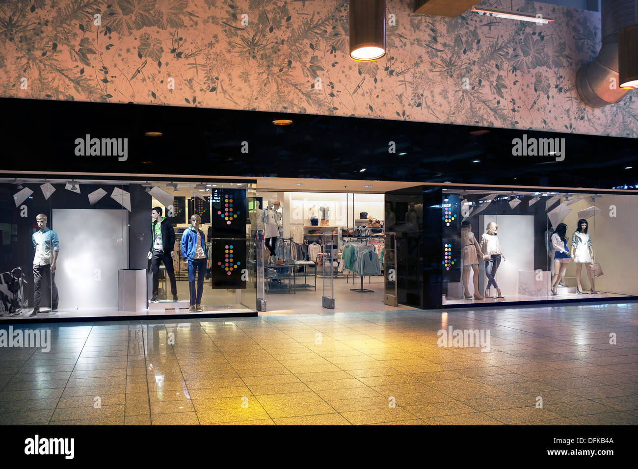 Retail shop entrance or exit. Facade of shop with display. Mannequin, dummy. - Stock Image