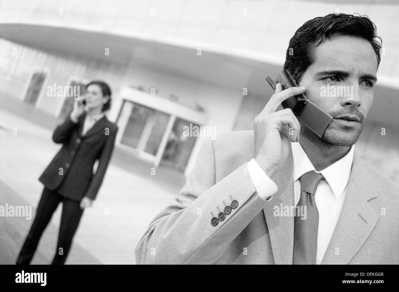 Executives talking on cellular phone Stock Photo