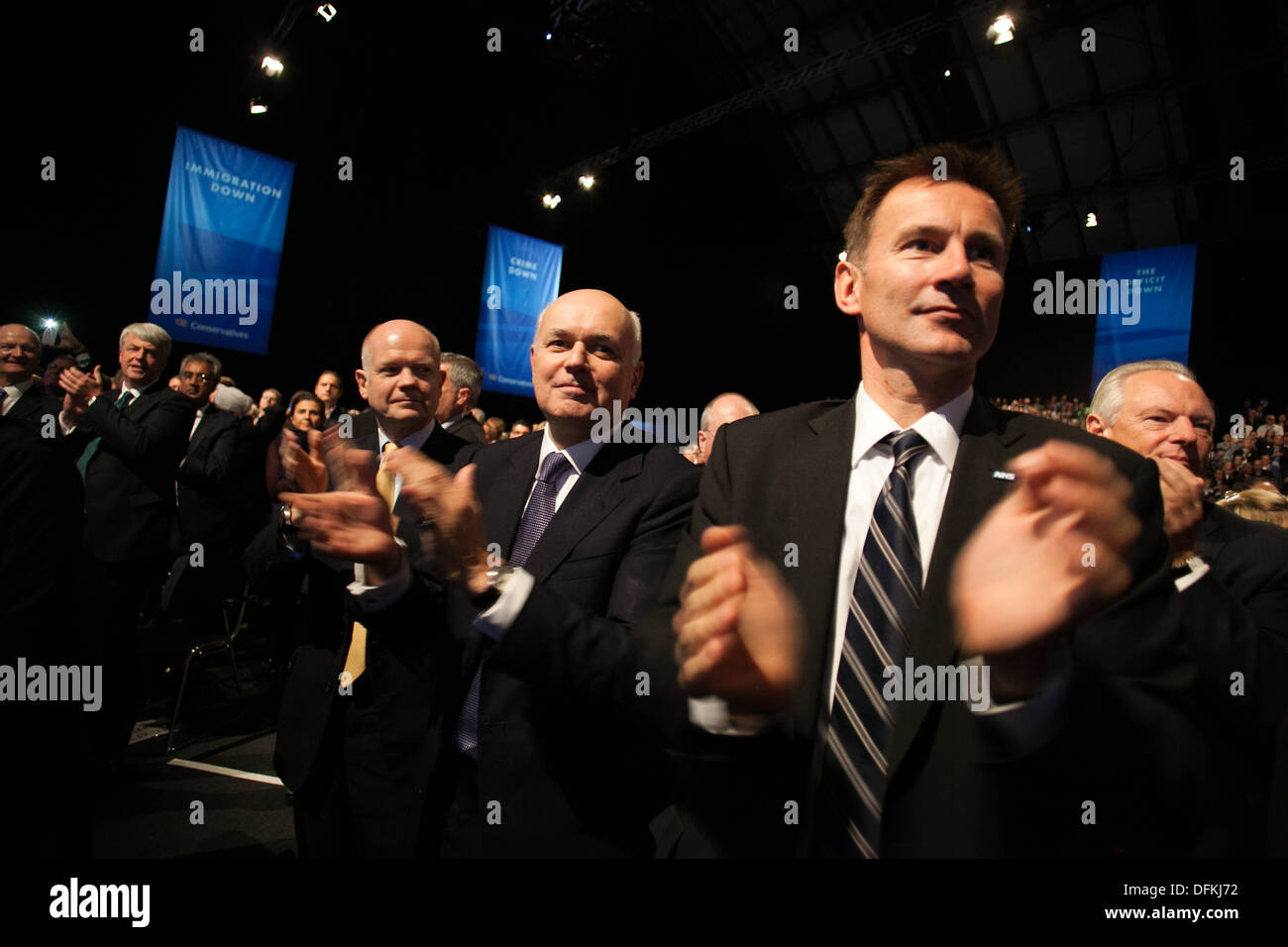 William Hague , Iain Duncan Smith and Jeremy Hunt watch David Cameron 's speech at Conservative Party Conference in Manchester - Stock Image