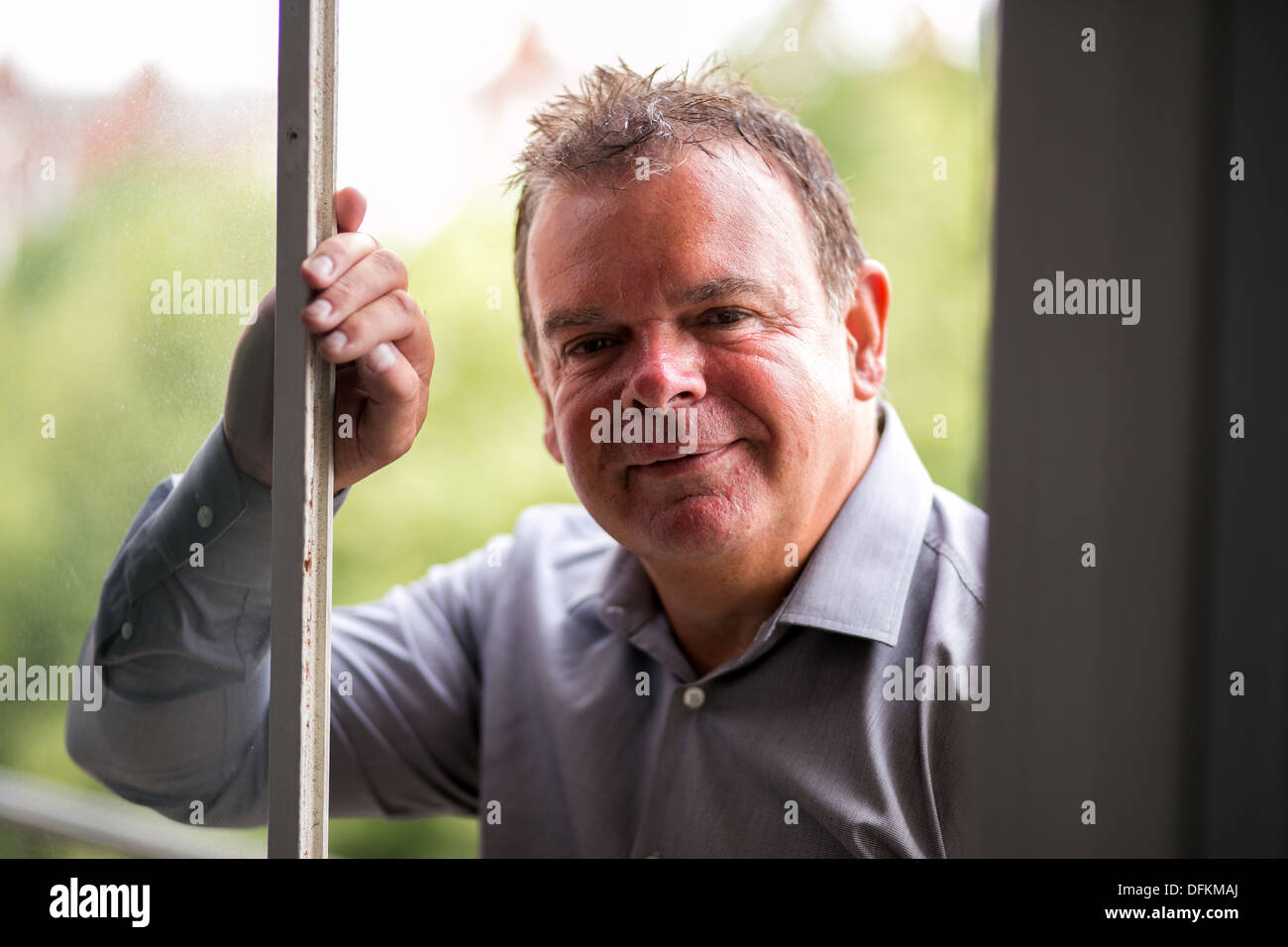15/07/13 Tony Nutall from Southern Fried Chicken at the company office in Southport - Stock Image