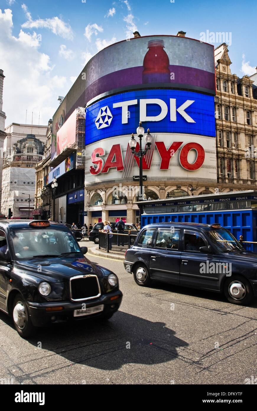 Taxis driving though Picadilly Circus  London, England, UK - Stock Image