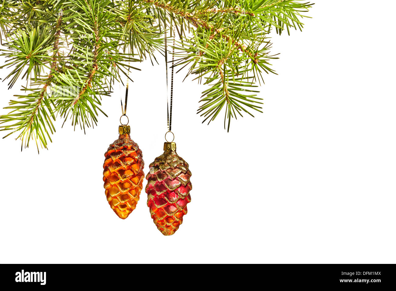 Christmas yellow and red cones toys and fur tree - Stock Image