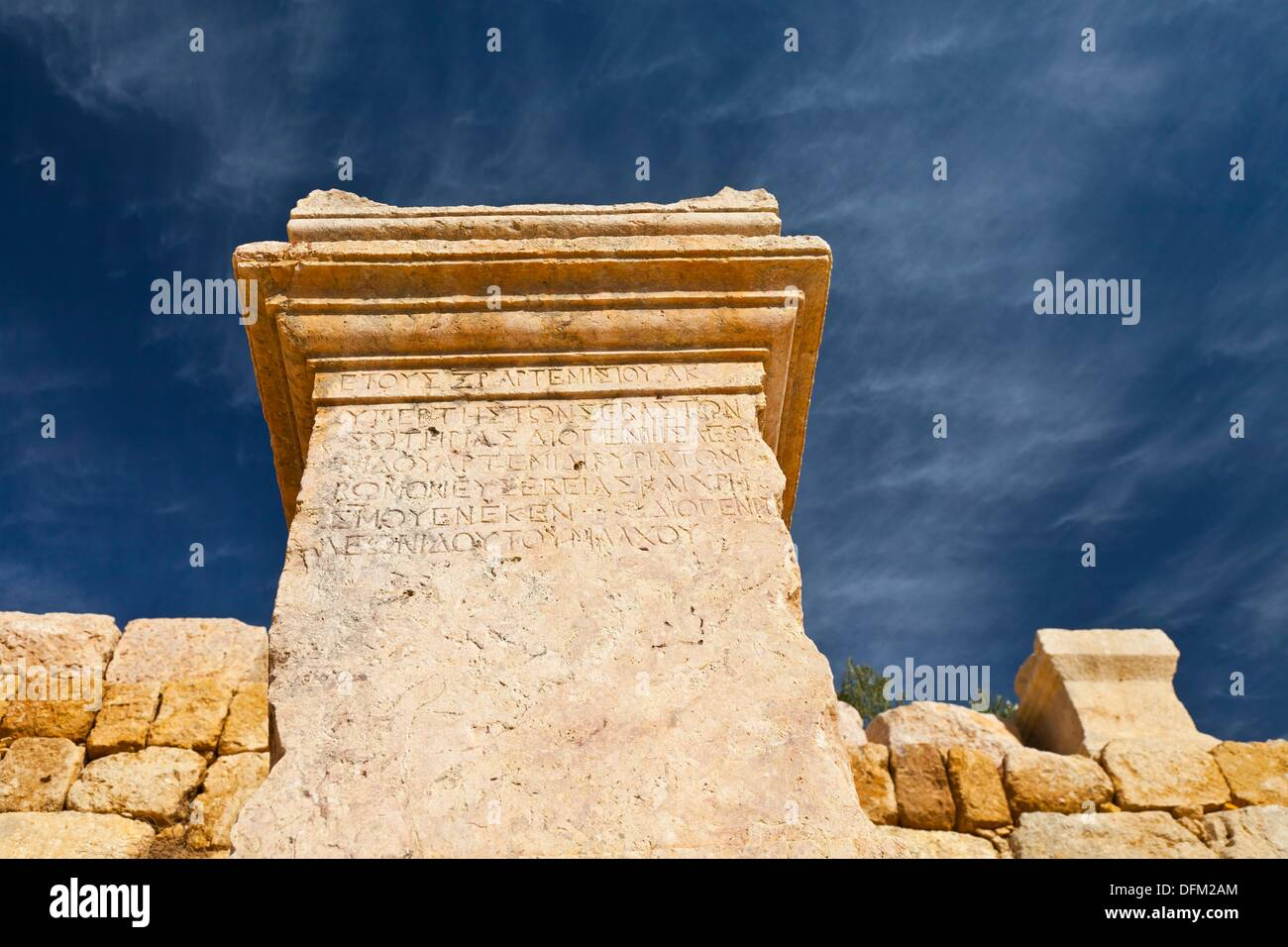 Greek inscription on plinth, Greco-Roman city of Jerash, Jordan, Middle East - Stock Image