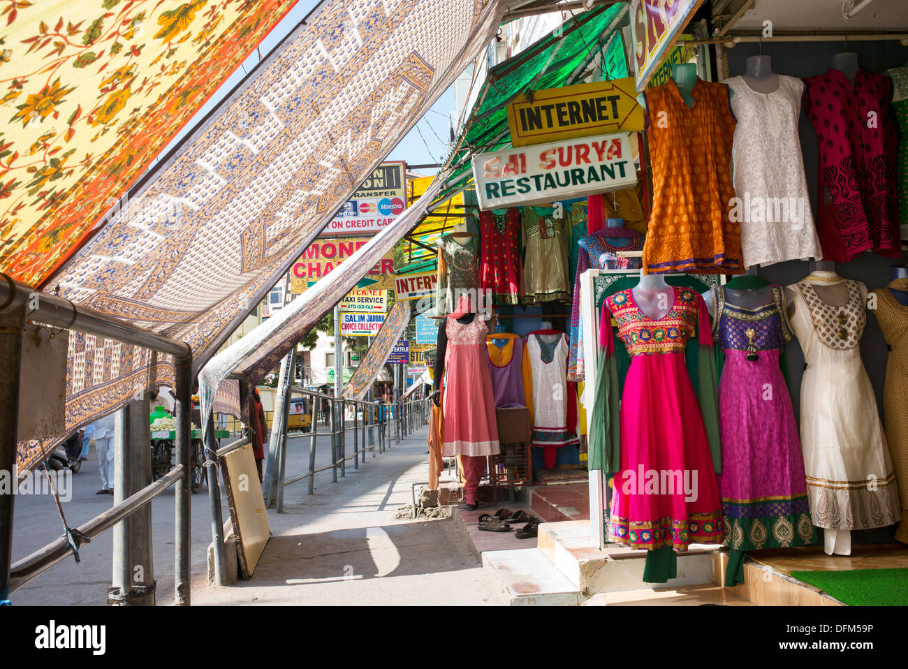 Puttaparthi high street shops protected from the sun by sheets. Andhra Pradesh, India - Stock Image