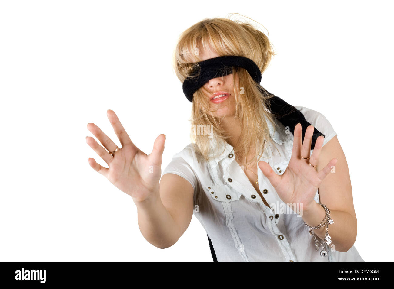 Beautiful young woman blindfold. Isolated on white - Stock Image