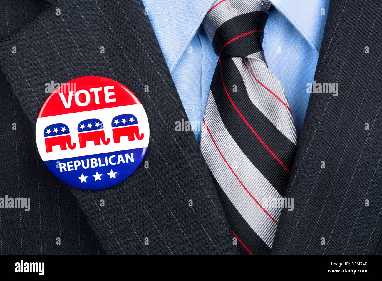 A republican voter proudly wears his party pin on his suit lapel. Stock Photo