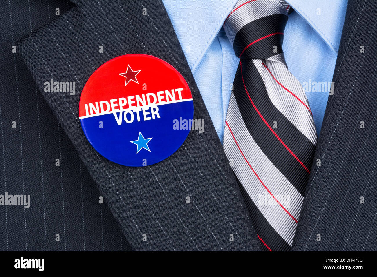 An independent voter wears his party pin on his suit lapel - Stock Image