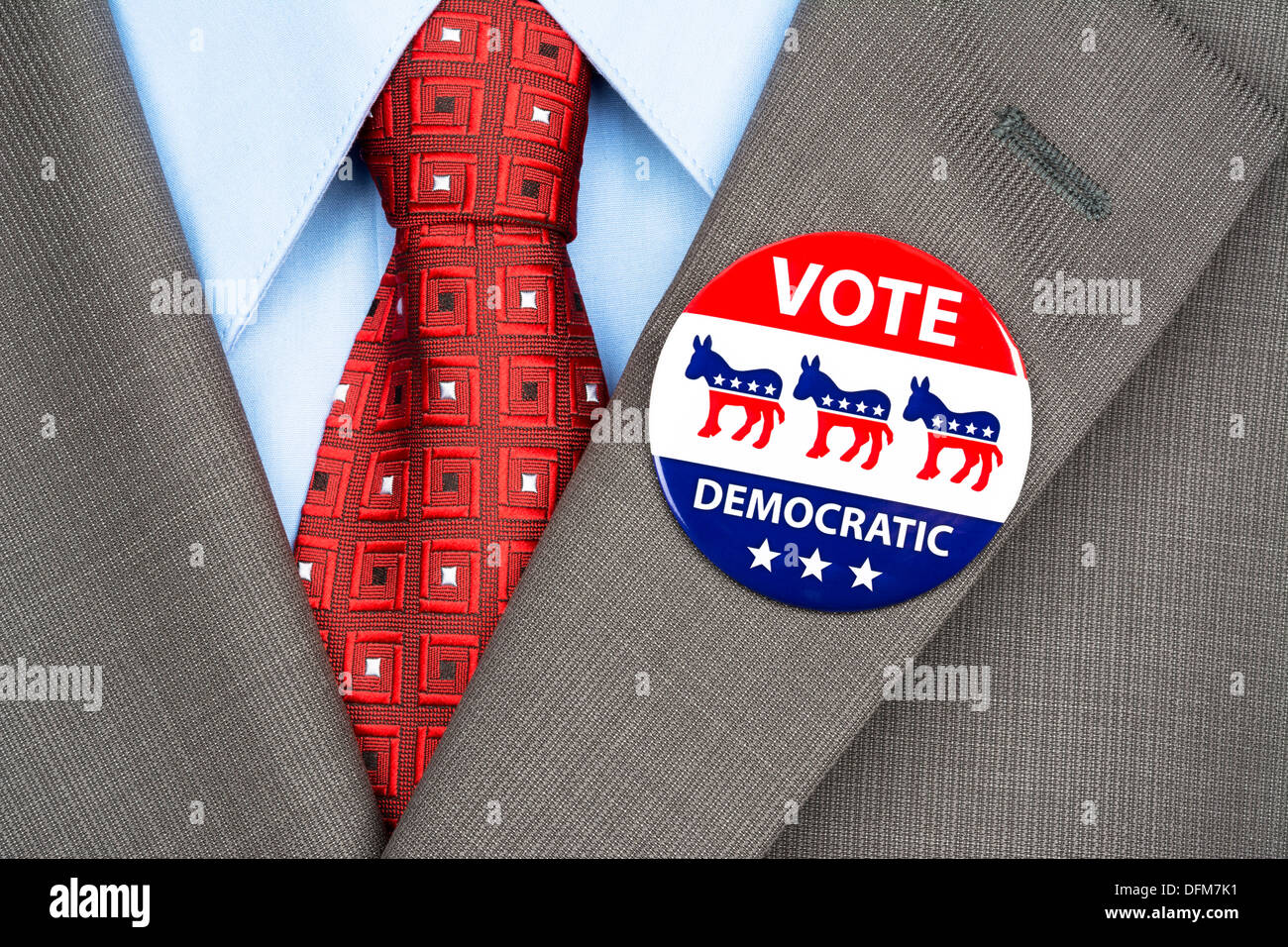 Close up of a democrat voting badge on the suit jacket lapel of an American voter. - Stock Image