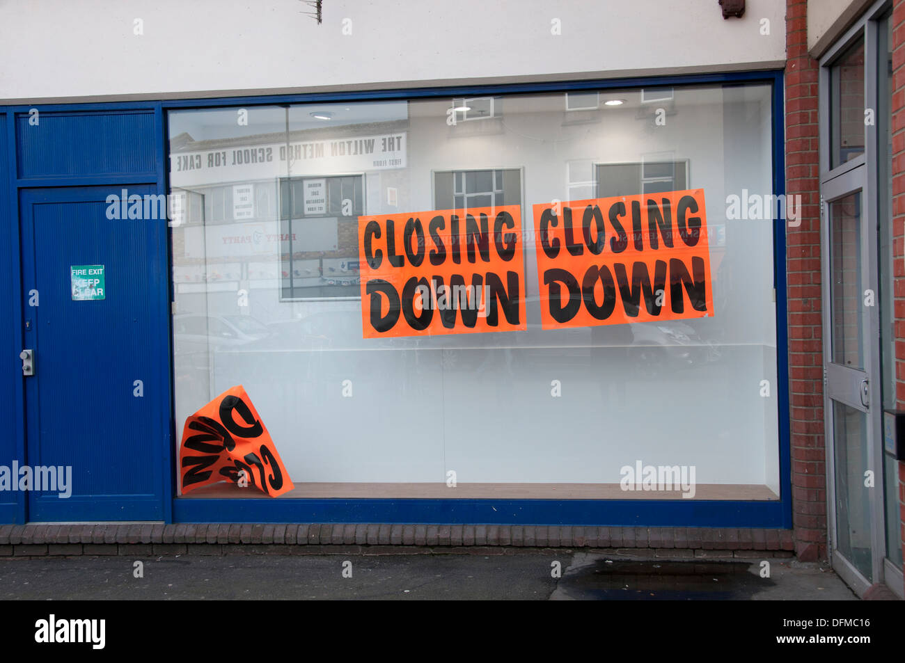 Hackney, London 2013. Ridley Road former police station with sign saying 'Closing Down'. - Stock Image