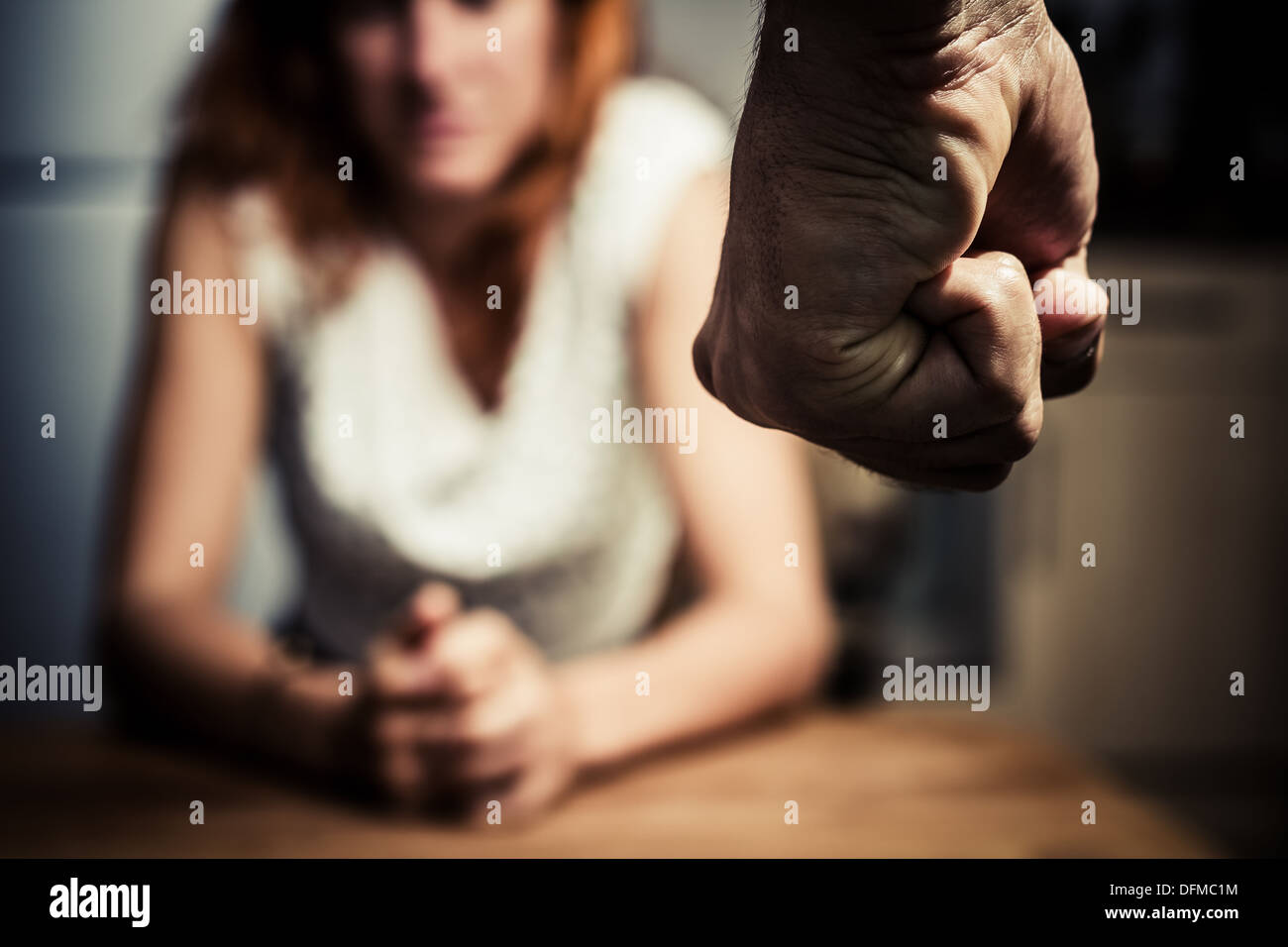 Close up on a man's fist with a woman in the background - Stock Image