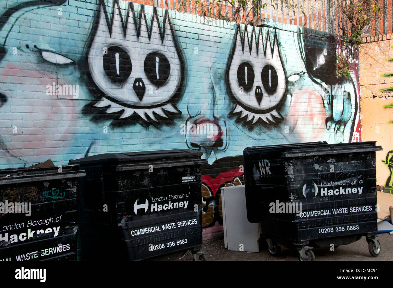 Hackney, London 2013. Graffiti and rubbish bins - Stock Image