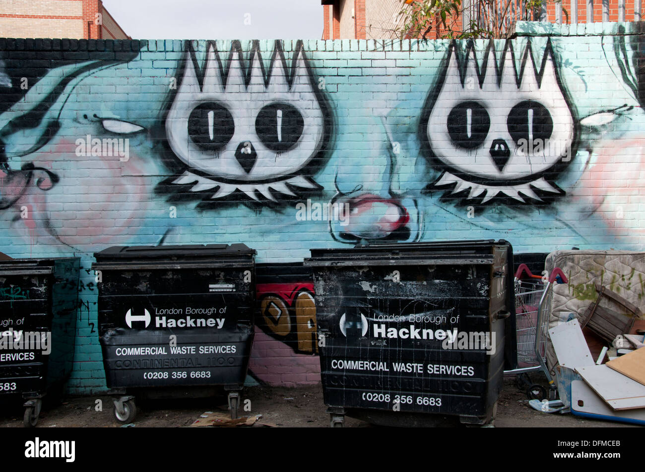 Hackney, London 2013. Graffiti and rubbish bins. - Stock Image