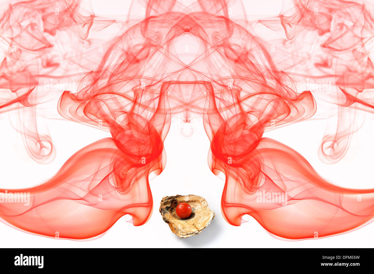 Red tomato on a seashell surrounded by a symmetrical composition of red smoke formed from - Stock Image