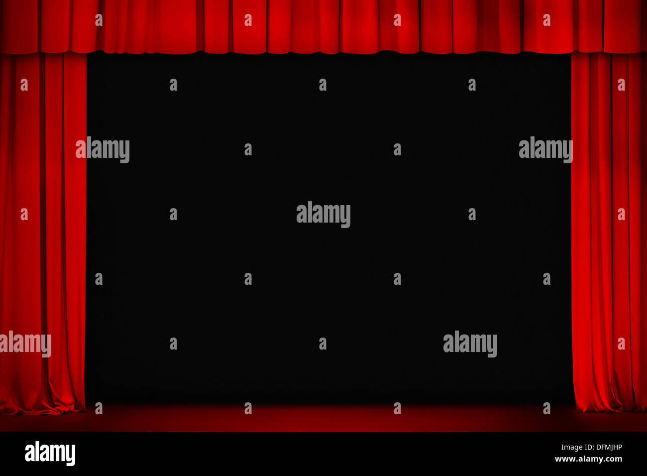 red curtain on theater or cinema stage wide open - Stock Image