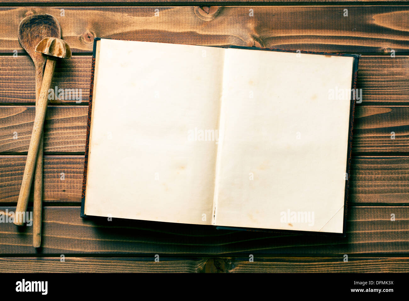 top view of recipe book with stirring spoons - Stock Image