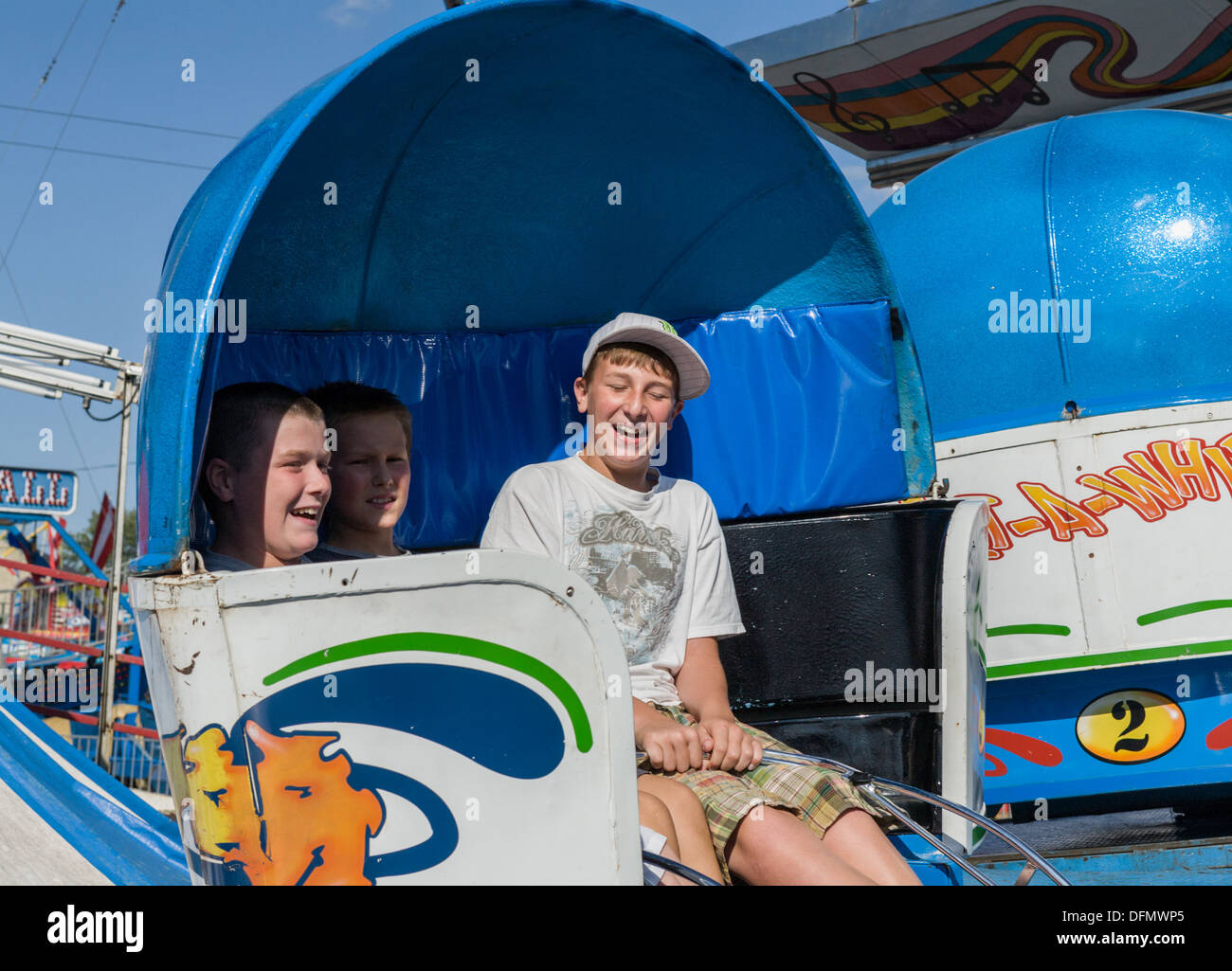 Boys on Tilt-a-Whirl ride, Great New York State Fair. - Stock Image