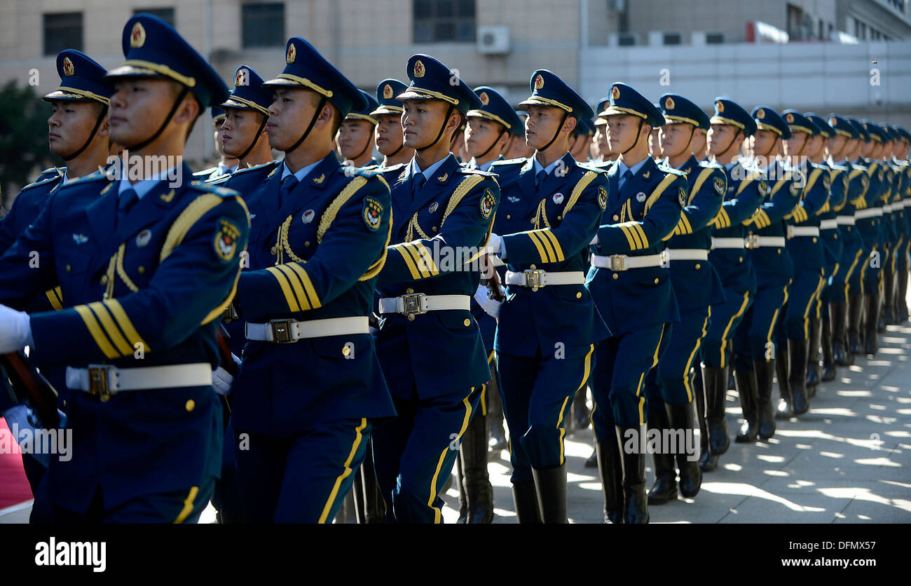 People's Liberation Army Air Force members march during a welcome ceremony in honor of Air Force Chief of Staff Gen. Mark A. Welsh III, hosted by PLAAF Commander Gen. Ma Xiaotian in Beijing, China, Sept. 25, 2013. Welsh, along with Gen. Herbert 'Hawk' Car - Stock Image