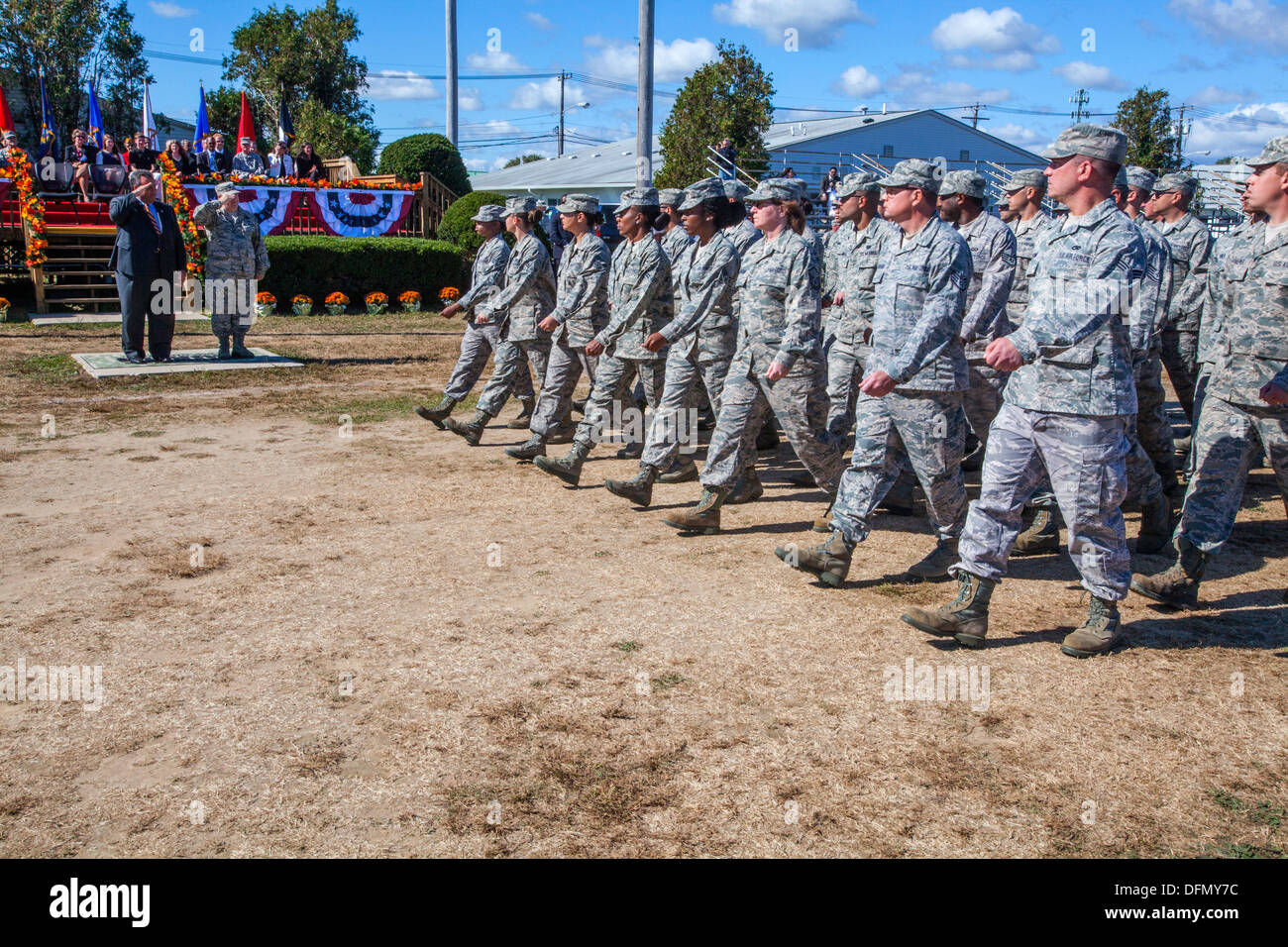 Members of the 108th Wing march past Gov. Chris Christie and Brig. Gen. Michael L. Cunniff, the Adjutant General of New Jersey, - Stock Image