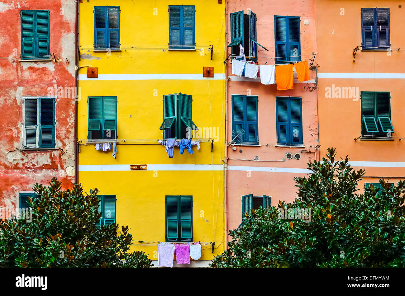 Detail of colorful house walls, windows and drying clothes, Cinque ...