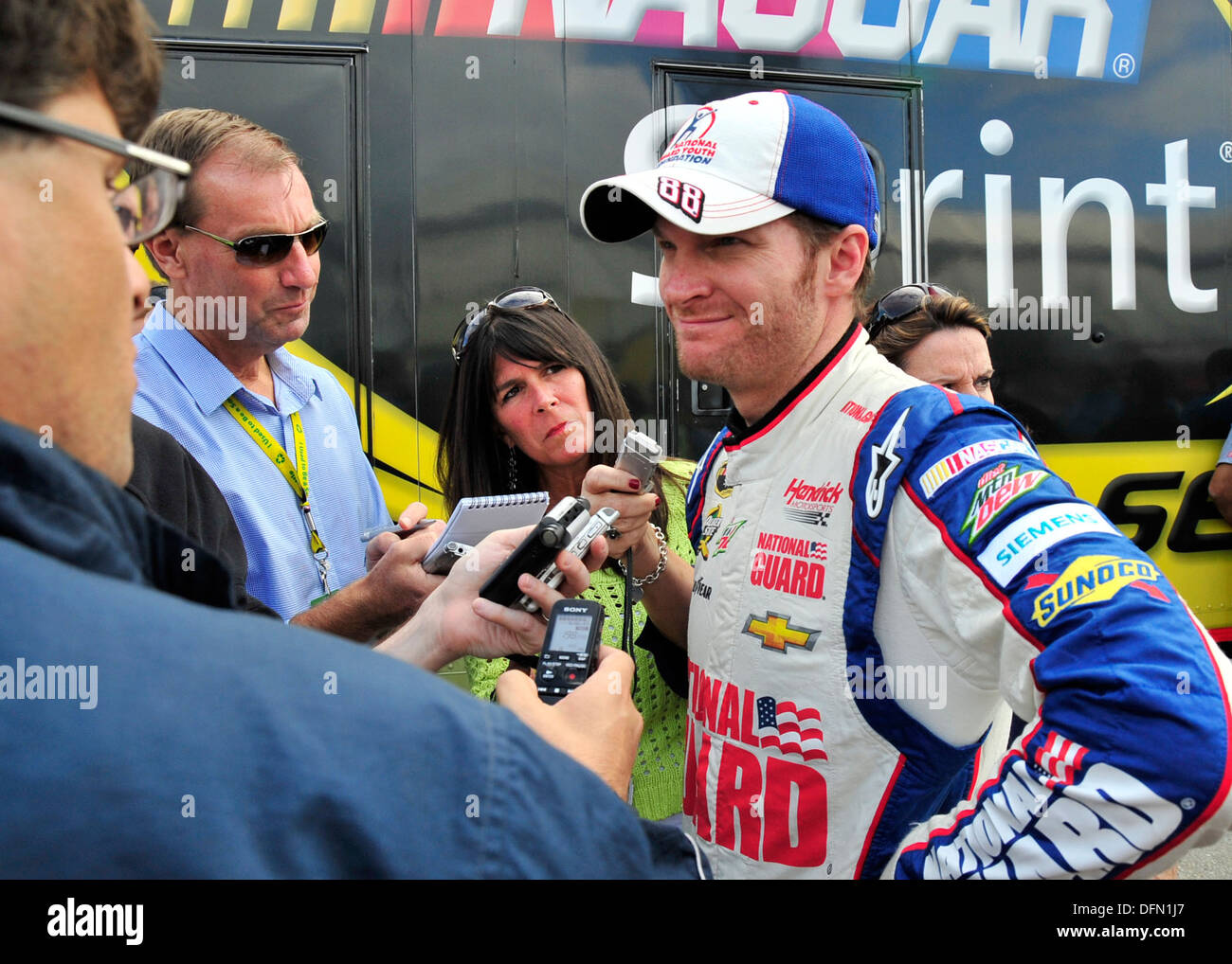 Dale Earnhardt, Jr., driver of the No. 88 National Guard Chevy, speaks to the media following his qualifying run for the AAA 400 Sept. 27, 2013, at Dover International Speedway in Dover, Del. Earnhardt earned the pole position, setting a new track record - Stock Image