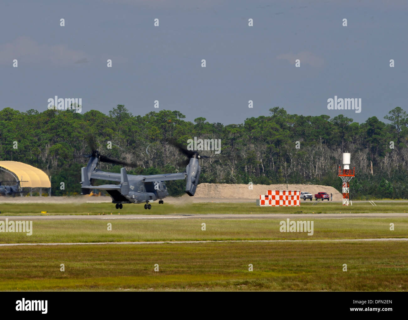 A U.S. Air Force CV-22 Osprey departs Hurlbut Field, Fla., Oct. 3, 2013. The aircraft is being relocated in preparation for the - Stock Image