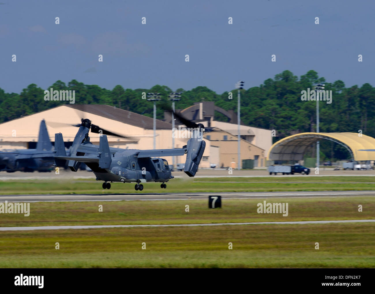 A U.S. Air Force CV-22 Osprey departs Hurlbut Field, Fla., Oct. 3, 2013. The aircraft is leaving as part of the preparations for the possible arrival of Tropical Storm Karen - Stock Image