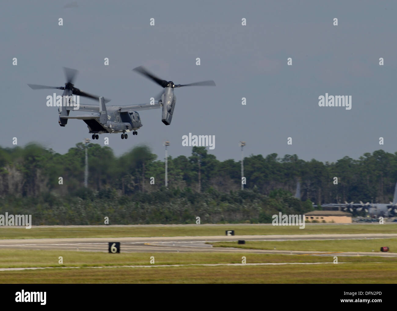 A U.S. Air Force CV-22 Osprey departs Hurlbut Field, Fla. Oct. 3, 2013. The aircraft is leaving as part of the preparation for the possible arrival of Tropical Storm Karen. - Stock Image