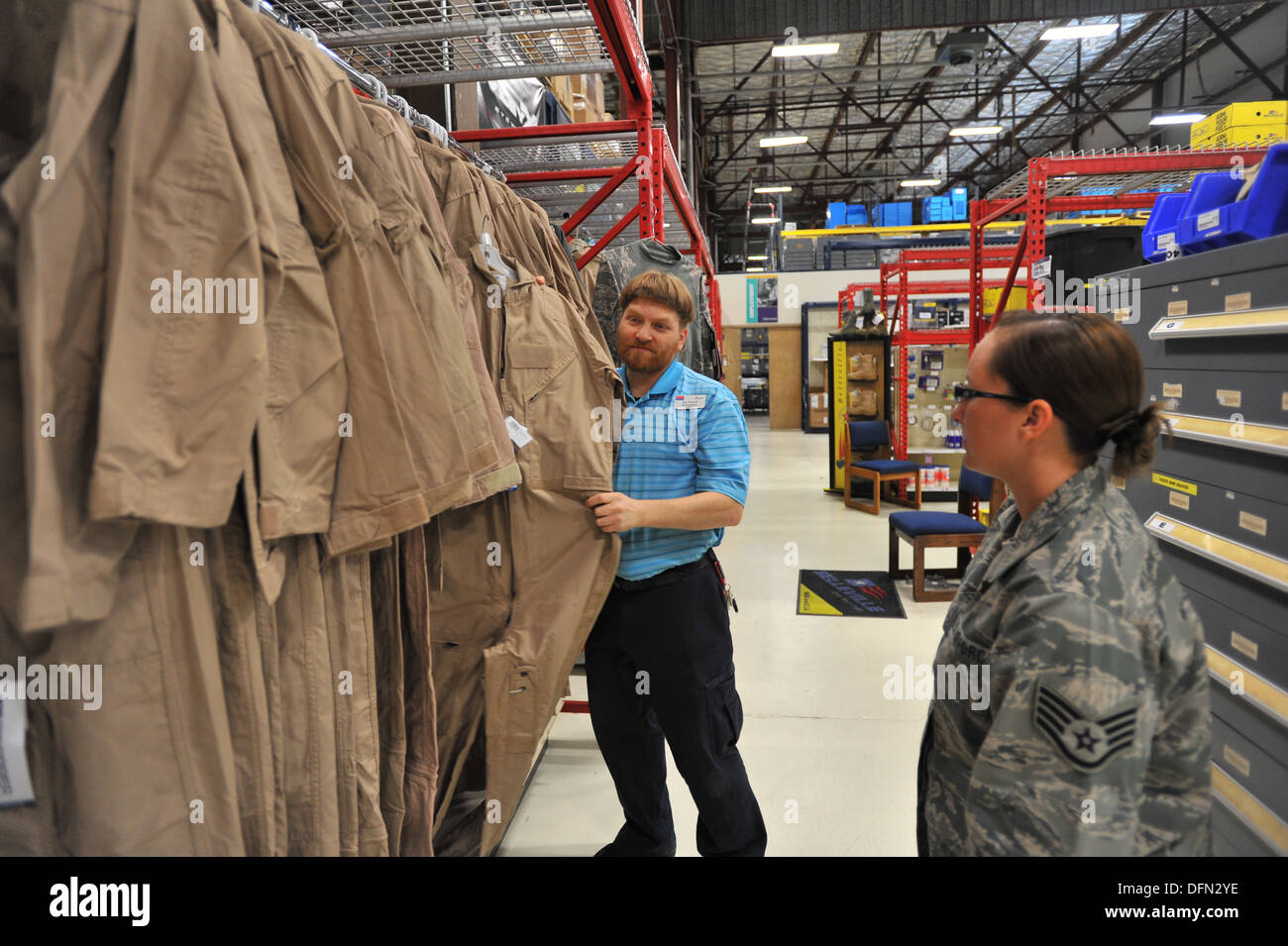 Eric Fornoff, Envision cashier, assists Staff Sgt. Cassie Kennedy, 242nd Combat Communications Squadron supply traditional, at the Base Supply Store at Fairchild Air Force Base, Wash., Sept. 30, 2013. Fornoff is legally blind and has been working on Fairc - Stock Image