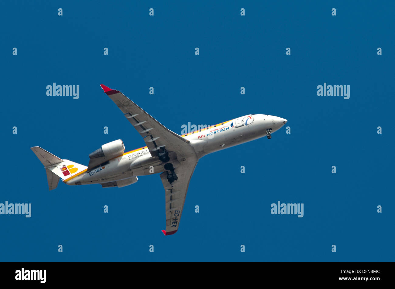 Commercial airliner on a blue background - Stock Image