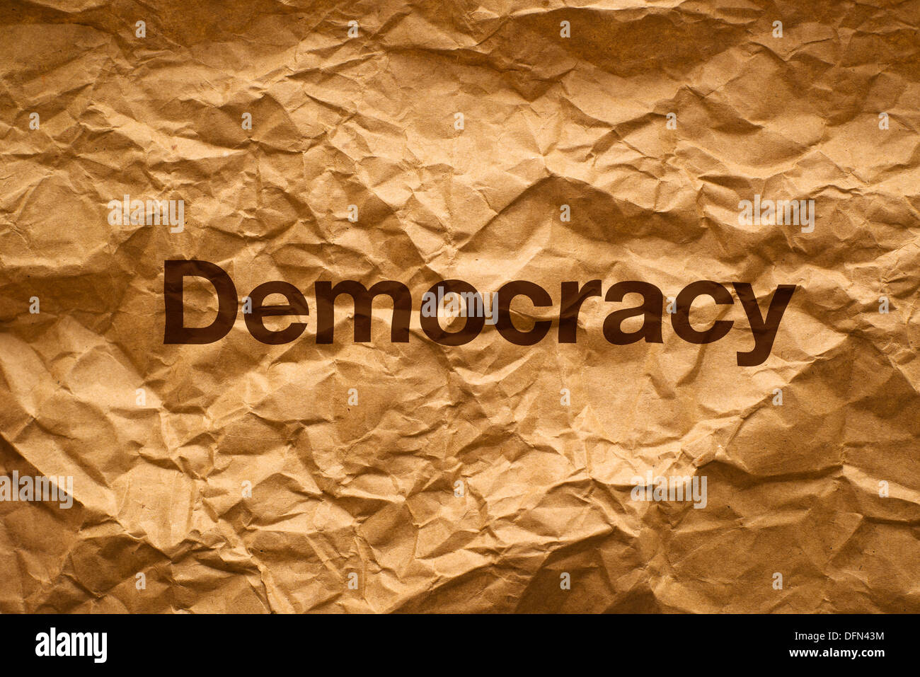Democracy on Crumpled paper texture - Stock Image