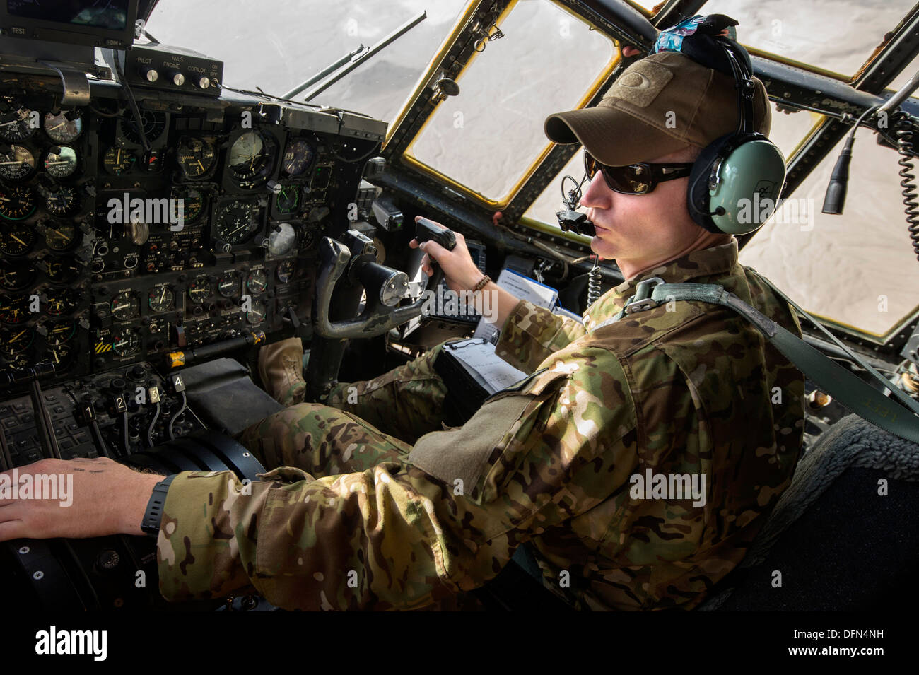 1st Lt. Brent Stevens, 774th Expeditionary Airlift Squadron pilot, maneuvers a C-130 Hercules towards Forward Operating Base Sharana, Paktika Province, Afghanistan, Sept. 28, 2013. This mission marked a retrograde milestone as the 774th EAS transported th - Stock Image
